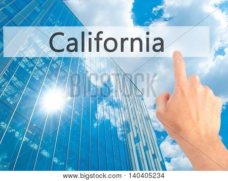 California - Hand Pressing A Button On Blurred Background Concept On Visual Screen.