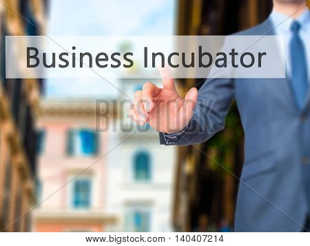Business Incubator -  Businessman Click On Virtual Touchscreen.