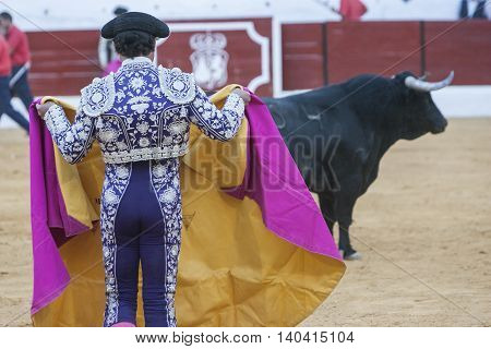 Sabiote SPAIN September 9 2011: The Spanish Bullfighter bullfighting with the crutch in the Bullring of Sabiote Spain