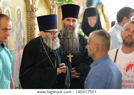 Orel Russia - July 28 2016: Russia baptism anniversary Divine Lutirgy. Senior Russian Orthodox church clergy in black robes with crosses closeup