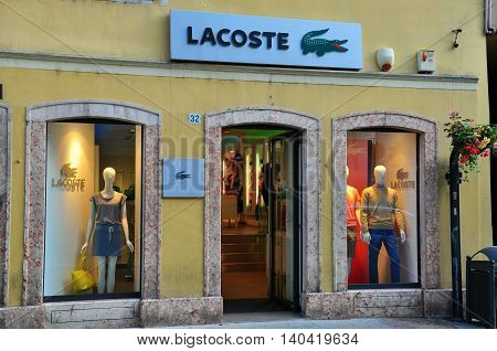 TRENTO ITALIA - JUNE 21: Facade of Lacoste store in Trento on June 21; 2014. Lacoste is a French clothing company founded in 1933.