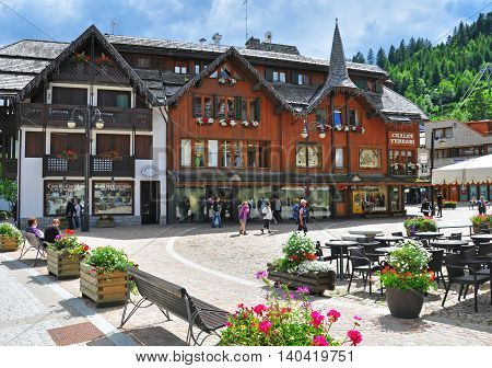 MADONNA DI CAMPIGLIO ITALY - JULY 11: View of the main square of Madonna di Campiglia town Italy on July 11 2014. Madonna di Campiglia is a ski resort in Dolomites Alps Italy.
