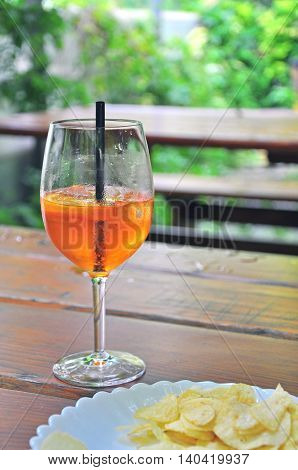 Glass of Spritz cocktail on summer terrace