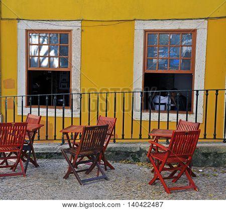 Cafe tables on the street of Alfama Lisbon