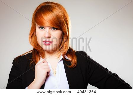 Portrait of beauty redhair business woman or student girl. Studio shot on gray background