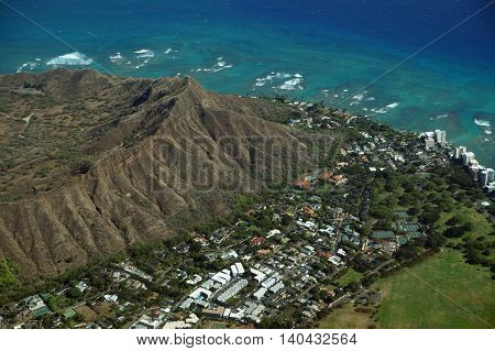 High Aerial view of Diamondhead Kapiolani Park the gold coast Pacific ocean and waves on Oahu Hawaii. April 2016.