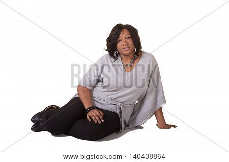 A portrait of a middle aged woman on a white background