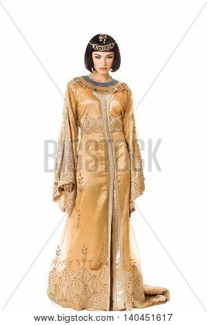 Fashion stylish beauty woman with black short haircut and professional make-up and golden dress of Cleopatra. Beautiful girl's in full lenght on white isolated background