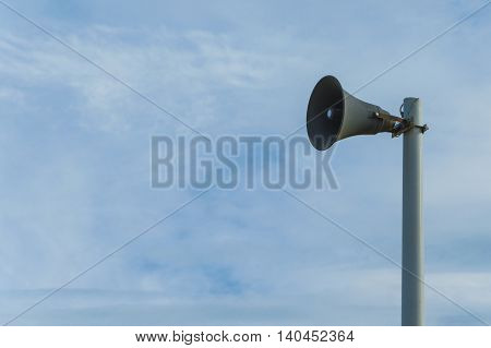 Isolated magaphone in a blue sky background