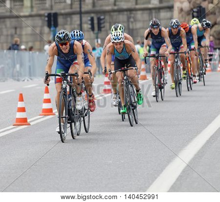STOCKHOLM SWEDEN - JUL 02 2016: Group of colorful male triathlete cyclists Gregory Barnaby (ITA) and competitors in the Men's ITU World Triathlon series event July 02 2016 in Stockholm Sweden