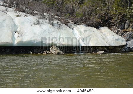 Glacier on the shore of Irkut River in its beginning in the Sayan Mountains in summer