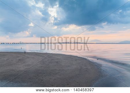 Sunrise by the shore with view of Penang Bridge