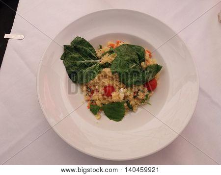 Couscous (aka seksu or kuskus) traditional berber North African steam cooked dish of durum wheat semolina granules