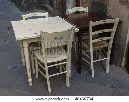 Tables and chairs of a dehors alfresco bar restaurant pub