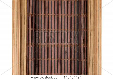Two bamboo mat twisted in the form of manuscript isolated on white background with space for your text
