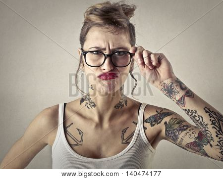 Disappointed tattooed girl