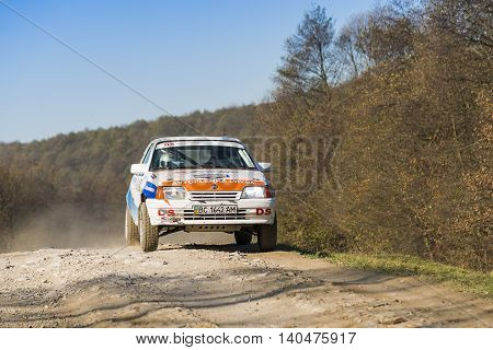 lLviv Ukraine - November 1 2015: Racers Oleg Slezinskij and Serhiy Bryckiy on the car brand Opel Kadett (No.29) overcome the track at the annual Rally of Galicia near the city of Lviv Ukraine