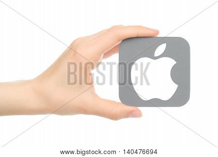 Kiev Ukraine - May 18 2016: Hand holds popular operating system logo printed on paper Apple ios. Apple Inc. is an American multinational technology company