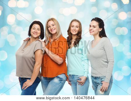 friendship, fashion, body positive, diverse and people concept - group of happy different size women in casual clothes over blue holidays lights background