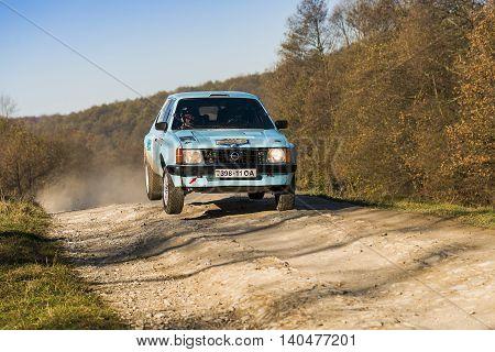 Lviv Ukraine - November 1 2015: Volodymyr Voloshyn's Opel Kadett (No.23) competes at the annual Rally Galicia