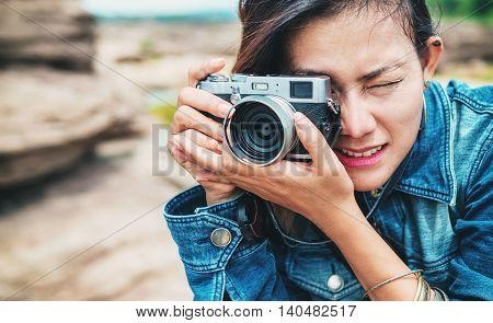 Asia woman taking a photo at Sampanbok natural stone park of Ubonratchathani Thailand