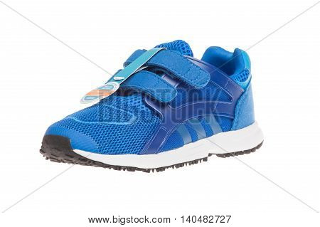 Varna Bulgaria - APRIL 16 2016 : ADIDAS ORIGINALS RACER LITE children shoe. Isolated on white. Product shot. Adidas is a German corporation that designs and manufactures sports shoes clothing and accessories