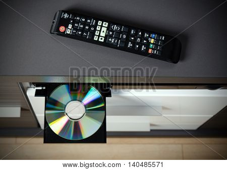 Remote control and Blu-ray or DVD player with inserted disc. poster