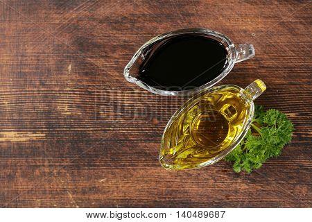 olive oil and balsamic vinegar in a glass gravy boat