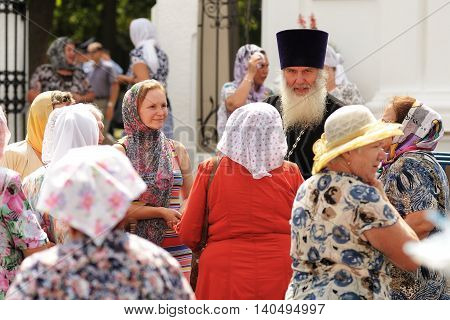 Orel Russia - July 28 2016: Russia baptism anniversary Divine Liturgy. Senior monk blessing women at church garden