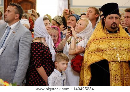 Orel Russia - July 28 2016: Russia baptism anniversary Divine Liturgy. Woman making selfie in church horizontal