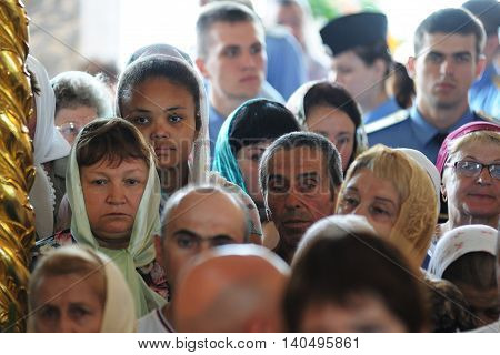 Orel Russia - July 28 2016: Russia baptism anniversary Divine Liturgy. African girl among Russian parisioners in church selective focus