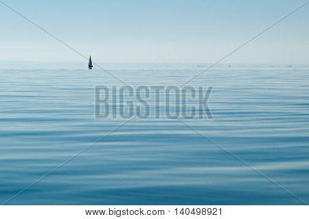 Minimalism: A lone sail away on the clean lake Balaton