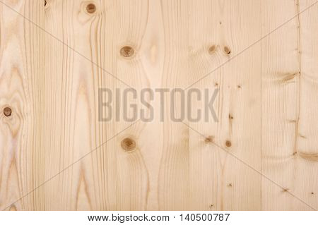 Wood panel background made of untreated wood.
