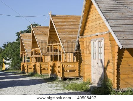 New wooden houses in the camping on a Sunny day