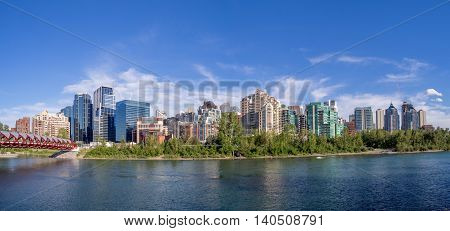 CALGARY, CANADA - JULY 8: Panoramic view of Calgary's downtown from the Peace Bridge which spans the Bow River on July 8, 2016 in Calgary, Alberta. Calgary is the center of Canada's oil industry.