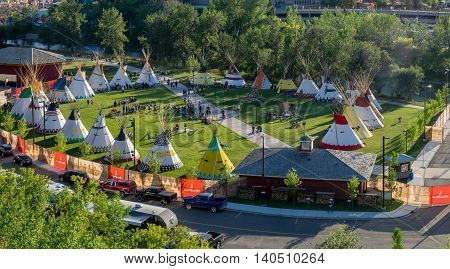 CALGARY, CANADA - JULY 8: Panoramic view of the Indian Village at the Calgary Stampede on July 8, 2016 in Calgary, Alberta. The Indian Village represents First Nations people at the Calgary Stampede.