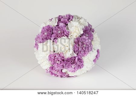 Wedding bouquet of white and purple carnations