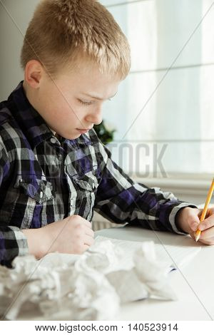 Boy With Writers Block Struggling With Homework