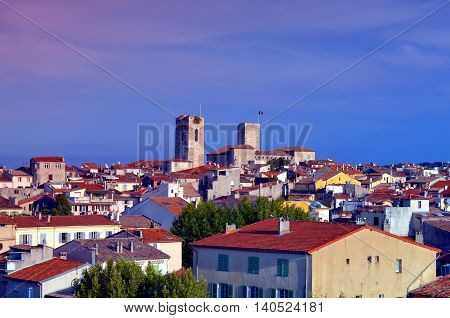 overview over the city of antibes, france at evening time