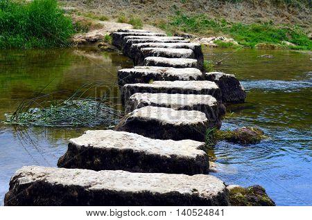 closeup of stepstones crossing a small river