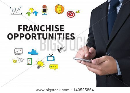 FRANCHISE OPPORTUNITIES businessman working use smartphone computer top