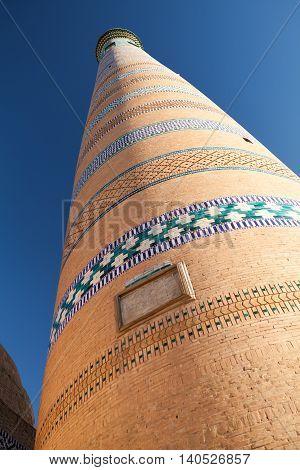 Close-up view of Islom Hoja Minaret in Itchan Kala - old centre of Khiva Khorezm Republic of Karakalpakstan Uzbekistan.