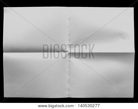 white uneven sheet of paper on the black background