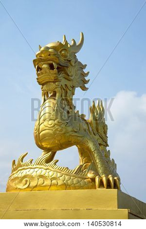 HUE, VIETNAM - JAN 07, 2016: Golden statue of a dragon in the forbidden Purple city Hue. Tourist landmark of the Vietnam