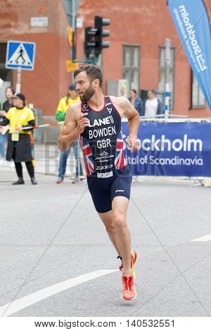 STOCKHOLM SWEDEN - JUL 02 2016: Running triathlete Adam Bowden (GBR) looking back in the old town of Stockholm in the Men's ITU World Triathlon series event July 02 2016 in Stockholm Sweden