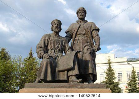 KAZAN, RUSSIA - APRIL 30, 2016: The sculpture of the architects of the Kazan Kremlin closeup, cloudy april day. Historical landmark of the city Kazan, Tatarstan