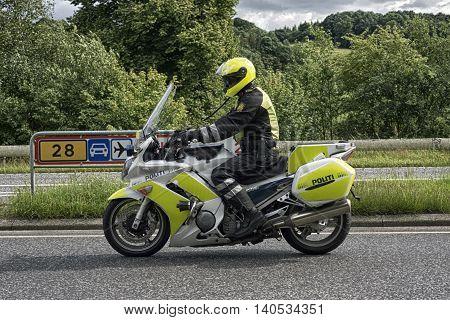 VEJLE DENMARK - JULY 29 2016: Danish policemen on bike in front of a bicycle race just outside Vejle July 29 2016.