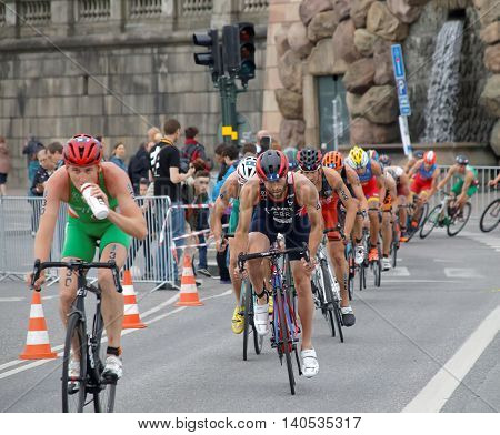 STOCKHOLM SWEDEN - JUL 02 2016: Group of colorful male triathlete cyclists Adam Bowden and competitors in the Men's ITU World Triathlon series event July 02 2016 in Stockholm Sweden