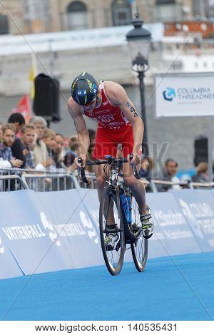 STOCKHOLM SWEDEN - JUL 02 2016: Male triathlete cyclist Lukas Pertl (AUT) in the Men's ITU World Triathlon series event July 02 2016 in Stockholm Sweden