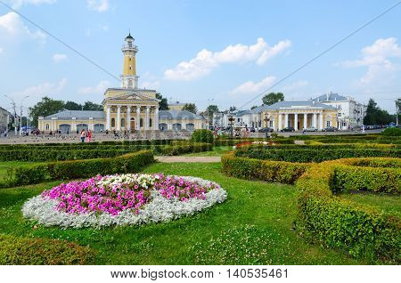 KOSTROMA RUSSIA - JULY 20 2016: Buildings fire tower and former guardhouse on Susaninskaya square Kostroma Golden Ring of Russia. Unidentified people are on square which is favorite place for recreation and meetings in city
